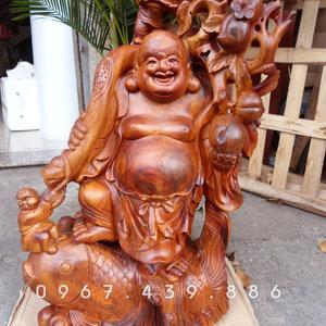 Tượng Phật Di Lặc vác cành đào cưỡi cá chép gỗ hương