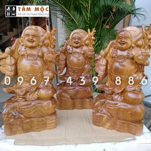 Tượng gỗ Phật Di Lặc vác cành đào bằng gỗ bách xanh